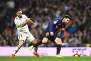 Lionel Messi of Barcelona is closed down by Daniel Carvajal of Real Madrid  during the La Liga match between Real Madrid CF and FC Barcelona at Estadio Santiago Bernabeu on March 02, 2019 in Madrid, Spain.