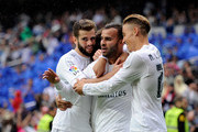 Jese Rodriguez of Real Madrid celebrates with Nacho (L) and Marcos Llorente after scoring Real's 3rd goal during the La Liga match between Real Madrid CF and Levante UD at estadio Santiago Bernabeu on October 17, 2015 in Madrid, Spain.