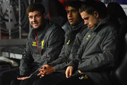(L-R) Steven Gerrard. Glen Johnson and Jordan Henderson of Liverpool look on from the bench during the UEFA Champions League Group B match between Real Madrid CF and Liverpool FC at Estadio Santiago Bernabeu on November 4, 2014 in Madrid, Spain.