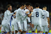 Pepe of Real Madrid CF celebrates scoring his team's fourth goal with team-mates Cristiano Ronaldo, Kaka (R) and Sergio Ramos (L) during the La Liga match between Real Madrid CF and RC Deportivo La Coruna at Bernabeu on September 30, 2012 in Madrid, Spain.