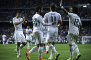 Gareth Bale (2ndR) of Real Madrid CF celebrates scoring their fifth goal with teammates James Rodriguez (L), Francisco Roman Alarcon alias Isco (2ndL) and Marcelo (R) during the La Liga match between Real Madrid CF and Real Betis Balompie at Estadio Santiago Bernabeu on August 29, 2015 in Madrid, Spain.