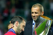 Diego Godin of Atletico Madrid is presented with the trophy by UEFA President, Aleksander Ceferin following the UEFA Super Cup between Real Madrid and Atletico Madrid at Lillekula Stadium on August 15, 2018 in Tallinn, Estonia.