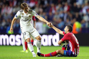 Luka Modric of Real Madrid helps up Koke of Atletico Madrid  during the UEFA Super Cup between Real Madrid and Atletico Madrid at Lillekula Stadium on August 15, 2018 in Tallinn, Estonia.
