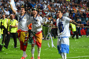 Pepe, Sergio Ramos and Ángel Di Maria of Real Madrid celebrate victory after the UEFA Champions League Final between Real Madrid and Atletico de Madrid at Estadio da Luz on May 24, 2014 in Lisbon, Portugal.