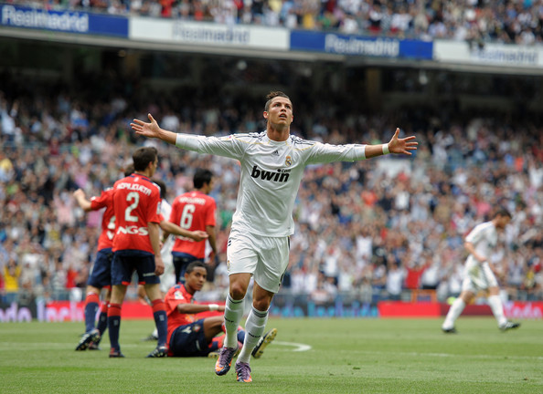 Cristiano Ronaldo of Real Madrid celebrates scoring his sides equalizing goal during the La Liga match between Real Madrid and Osasuna at the Estadio Santiago Bernabeu on May 2, 2010 in Madrid, Spain.
