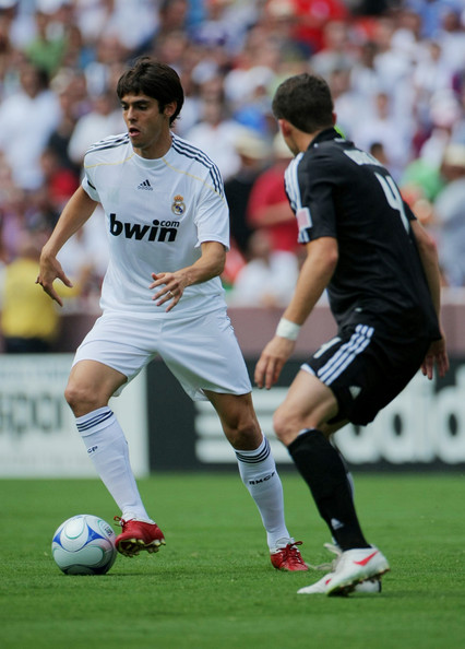 Kaka #8 of Real Madrid attempts to dribble around Mark Burch #4 of D.C. United during the friendly match at FedExField on August 9, 2009 in Landover, Maryland.