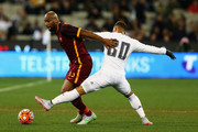 Maicon of AS Roma and Jese Rodriguez of Real Madrid contest the ball during the International Champions Cup friendly match between Real Madrid and AS Roma at the Melbourne Cricket Ground on July 18, 2015 in Melbourne, Australia.