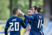 Gareth Bale of Real Madrid celebrates with his teammate Sergio Ramos and Jese Rodriguez of Real Madrid after scoring the opening goal during the La Liga match between Real Sociedad de Futbol and Real Madrid at Estadio Anoeta on April 30, 2016 in San Sebastian, .