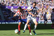 Koke of  Club Atletico de Madrid . is tackled by Michel of Real Valladolid CF during the Liga match between Real Valladolid CF and Club Atletico de Madrid at Jose Zorrilla on October 06, 2019 in Valladolid, Spain.
