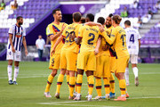 Arturo Vidal of Barcelona celebrates with teammates after scoring his team's first goal during the Liga match between Real Valladolid CF and FC Barcelona at Jose Zorrilla on July 11, 2020 in Valladolid, Spain. Football Stadiums around Europe remain empty due to the Coronavirus Pandemic as Government social distancing laws prohibit fans inside venues resulting in all fixtures being played behind closed doors.