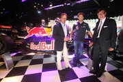 Team Principal Christian Horner, Red Bull Racing Driver Mark Webber and Founder and Chairman of Geox Mario Moretti Polegato attend a photocall for the super breathable Geox racing shoe, created for Red Bull Drivers at Harrods on July 5, 2011 in London, England.