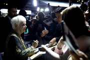 Judi Dench writes autographs as she attends the 'Red Joan' premiere and Golden Icon Award during the 14th Zurich Film Festival at Festival Centre on October 03, 2018 in Zurich, Switzerland.