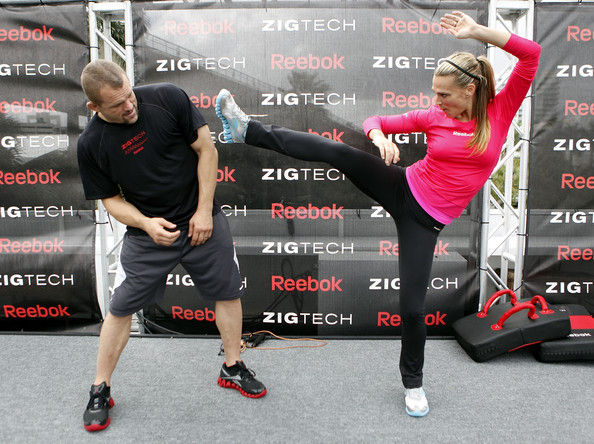 Actress Molly Sims (R) and MMA fighter Chuck Liddell spar during the Reebok