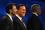 Republican presidential candidate Rick Santorum (C) smiles while George Pataki (R) and Louisiana Gov. Bobby Jindal  look on during the CNBC Republican Presidential Debate at University of Colorado's Coors Events Center October 28, 2015 in Boulder, Colorado.  Fourteen Republican presidential candidates are participating in the third set of Republican presidential debates.
