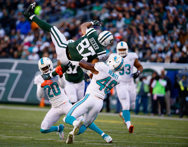Miami Dolphins v New York Jets [sports,canadian football,team sport,ball game,player,gridiron football,super bowl,tournament,sports gear,sport venue,eric decker,reshad jones 20,catch,metlife stadium,new jersey,east rutherford,new york jets,miami dolphins,neville hewitt 46,game]