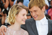 """Actress Mia Wasikowska and actor Henry Hopper attend the """"Restless"""" photocall during the 64th Annual Cannes Film Festival on May 13, 2011 in Cannes, France."""
