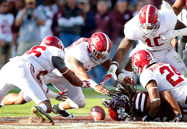 Alabama v Mississippi State [sports gear,sports,helmet,football gear,team sport,football helmet,ball game,canadian football,player,gridiron football,marlon humphrey,ryan anderson,geno matias-smith 24,reuben foster 10,v,dive,alabama,mississippi state,alabama crimson tide,fumble]