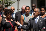 (L - R) Gwen Carr, mother of the late Eric Garner, and widow Esaw Garner listen as Rev. Al Sharpton speaks to the press after meeting with Department of Justice officials, June 21, 2017 in the Brooklyn borough of New York City. The family was expected to receive a status report on the progress of the civil rights investigation into Eric Garner's police-involved choking death.
