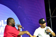 Killer Mike and T.I. speak onstage during day 3 of REVOLT Summit x AT&T Summit on September 14, 2019 in Atlanta, Georgia.