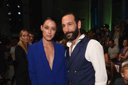 Massimo Sinato and Rebecca Mir attend the Riani show during the Berlin Fashion Week Spring/Summer 2019 at ewerk on July 4, 2018 in Berlin, Germany.