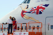 Founder and President of Virgin Group Sir Richard Branson (L) and burlesque artist Dita Von Teese appear on a lift in front of a painting of Von Teese on the side of a Virgin Atlantic Airways 747-400 aircraft at McCarran International Airport June 15, 2010 in Las Vegas, Nevada. Branson is celebrating his British airline's 10th anniversary of flying between London and Las Vegas.