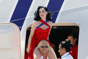 Founder and President of Virgin Group Sir Richard Branson carries burlesque artist Dita Von Teese on his shoulders as they board a Virgin Atlantic Airways 747-400 aircraft to pose for photos at McCarran International Airport June 15, 2010 in Las Vegas, Nevada. Branson is celebrating his British airline's 10th anniversary of flying between London and Las Vegas.