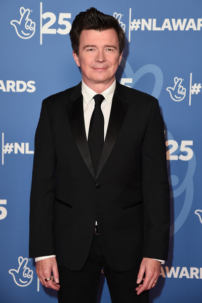 BBC1's National Lottery Awards 2019 - Red Carpet Arrivals [suit,formal wear,tuxedo,white-collar worker,premiere,event,tie,electric blue,carpet,blazer,red carpet arrivals,rick astley,england,london,bbc television centre,bbc1,national lottery awards]