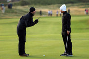 Suzzann Pettersen of Norway in consultation with LPGA Tour referee Bo Ream about her ball that was oscillating on the spot due to high winds on the 12th green, play was suspended shortly after during the second round of the 2012 Ricoh Women's British Open at Royal Liverpool on September 14, 2012 in Hoylake, England.