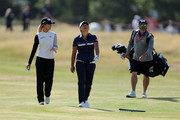 Lydia Ko of New Zealand (L) and Yani Tseng of Taiwan (middle) walks down the fairway during a pro-am round ahead of the Ricoh Women's British Open at Royal Lytham & St. Annes on August 1, 2018 in Lytham St Annes, England.