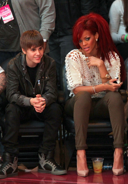 Rihanna Singers Justin Bieber (L) and Rihanna sit in the audience during the 2011 NBA All-Star game at Staples Center on February 20, 2011 in Los Angeles, California. NOTE TO USER: User expressly acknowledges and agrees that, by downloading and or using this photograph, User is consenting to the terms and conditions of the Getty Images License Agreement.