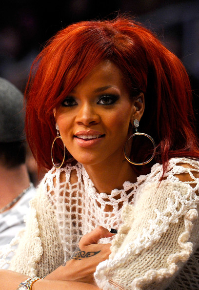 Rihanna Singer Rihanna sits in the audience during the 2011 NBA All ...
