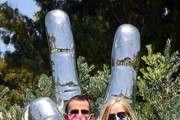 (L-R) Ringo Starr and Barbara Bach visit his 'Peace and Love' sculpture to celebrate his 80th birthday on July 07, 2020 in Beverly Hills, California.