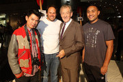 Sir Ian McKellen (2nd R) poses with Small Black's Nua Finau (R) Former All Black and artist Josh Kronfiled (2nd L), and artist Garry Young (L) who all pained a picture for an auction during the Rise Up Christchurch telethon appeal event at Te Papa on May 22, 2011 in Wellington, New Zealand. The 12-hour global telethon to support vicitims of the February 11 Christchurch earthquake was broadcast accross New Zealand with live crosses to events in London, Los Angeles and Sydney.