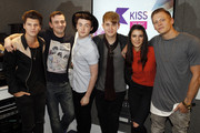 Charlie Bagnall, Jake Roche, Danny Wilkin and Lewi Morgan of the band 'Rixton' pictured with Michael and Andrea during a visit to Kiss FM on April 22, 2015 in London, England.