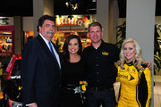 NASCAR President Mike Helton, Robin Meade of CNN Headline News, Clint Bowyer, driver of the #15 5-hour Energy Toyota, and Miss Sprint Cup Jaclyn Roney (L-R) pose for a photograph during the Road to Daytona Fueled By Sunoco at CNN Center on February 11, 2013 in Atlanta, Georgia.