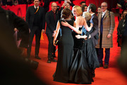 """(L-R) Salma Hayek, Elle Fanning, director Sally Potter and Javier Bardem pose at the """"The Roads Not Taken"""" premiere during the 70th Berlinale International Film Festival Berlin at Berlinale Palace on February 26, 2020 in Berlin, Germany."""
