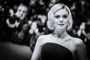 """Image was converted to black and white) Elle Fanning arrives for the """"The Roads Not Taken"""" premiere during the 70th Berlinale International Film Festival Berlin at Berlinale Palace on February 26, 2020 in Berlin, Germany."""