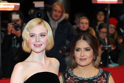 """(L-R) Elle Fanning and Salma Hayek pose at the """"The Roads Not Taken"""" premiere during the 70th Berlinale International Film Festival Berlin at Berlinale Palace on February 26, 2020 in Berlin, Germany."""
