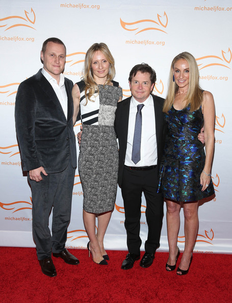2014 A Funny Thing Happened On The Way To Cure Parkinson's [red,carpet,event,red carpet,fashion,premiere,flooring,award,suit,dress,anne-cecilie speyer,rob speyer,michael j. fox,tracy pollan,happened on the way to cure parkinsons,l-r,waldorf,astoria,new york city,event]