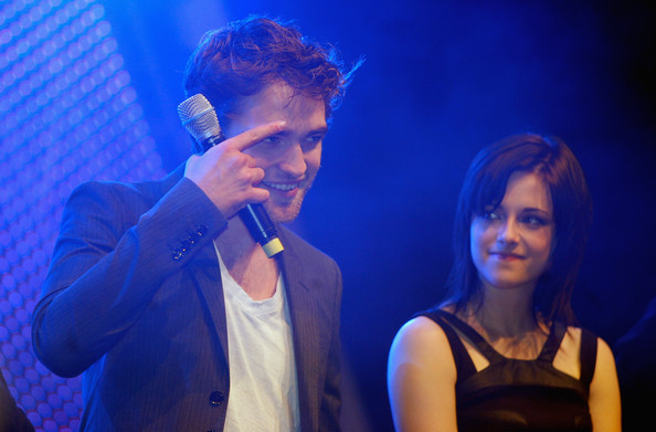 Actors Robert Pattinson and Kristen Stewart present their new film The Twighlight Saga- New Moon during the HVB youth event at the Olympic Hall on November 14, 2009 in Munich, Germany.