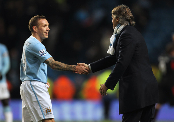 craig bellamy and roberto mancini of manchester city