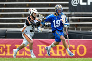 Jordan Wolf #32 of the Rochester Rattlers defends Kevin Drew #19 of the Charlotte Hounds during their game at American Legion Memorial Stadium on April 12, 2015 in Charlotte, North Carolina.