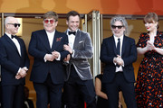 "(L-R) Bernie Taupin, Sir Elton John, Taron Egerton, Director Dexter Fletcher and Bryce Dallas Howard attend the screening of ""Rocket Man"" during the 72nd annual Cannes Film Festival on May 16, 2019 in Cannes, France."