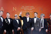 "(L-R) Giles Martin, David Furnish, Bernie Taupin, Sir Elton John, Taron Egerton, Director Dexter Fletcher and Bryce Dallas Howard attend the screening of ""Rocket Man"" during the 72nd annual Cannes Film Festival on May 16, 2019 in Cannes, France."
