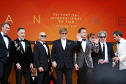 "(L-R) Giles Martin, David Furnish, Bernie Taupin, Sir Elton John, Taron Egerton, Bryce Dallas Howard, Director Dexter Fletcher and Richard Madden attend the screening of ""Rocket Man"" during the 72nd annual Cannes Film Festival on May 16, 2019 in Cannes, France."