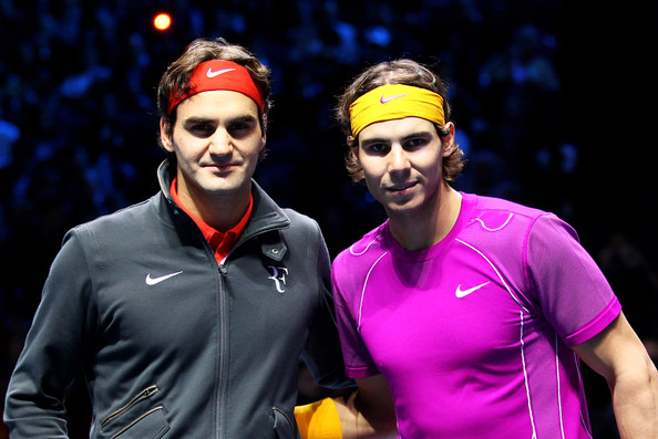 Roger Federer Roger Federer of Switzerland (L) and Rafael Nadal of Spain (R) pose on court before their men's final during the ATP World Tour Finals at O2 Arena on November 28, 2010 in London, England.