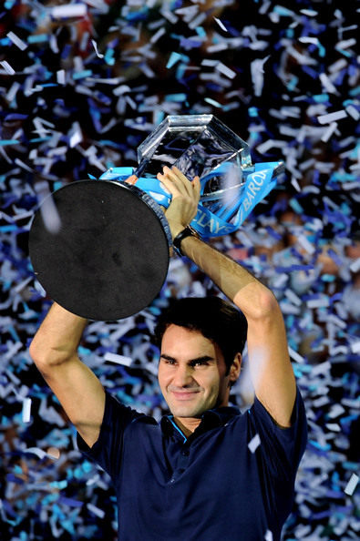 Roger Federer Roger Federer of Switzerland lifts the trophy following his victory during the men's final singles match against Jo-Wilfried Tsonga of France during the Barclays ATP World Tour Finals at the O2 Arena on November 27, 2011 in London, England.