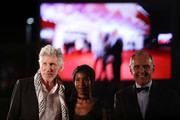 "Roger Waters, unknown guest and Venice Film Festival Director Alberto Barbera walk the red carpet ahead of the ""Roger Waters Us + Them"" screening during the 76th Venice Film Festival at Sala Darsena on September 06, 2019 in Venice, Italy."