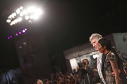 """Roger Waters and unknown guest walk the red carpet ahead of the """"Roger Waters Us + Them"""" screening during the 76th Venice Film Festival at Sala Darsena on September 06, 2019 in Venice, Italy."""