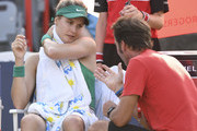 Eugenie Bouchard of Canada speaks with her coach against Elise Mertens of Belgium during day two of the Rogers Cup at IGA Stadium on August 7, 2018 in Montreal, Quebec, Canada.